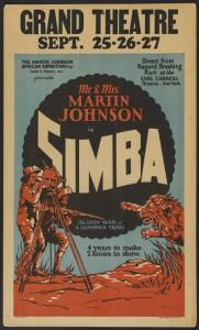 Simba –zowel bejaagd met het geweer als met de camera (Wikimedia commons).
